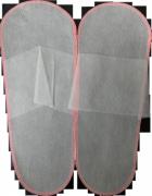Тапочки одноразовые в упаковке 10 пар.